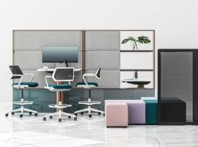 Three Steelcase Qivi stools around a Mackinac worksurface with B-Free cubes and Screen pictured next to it