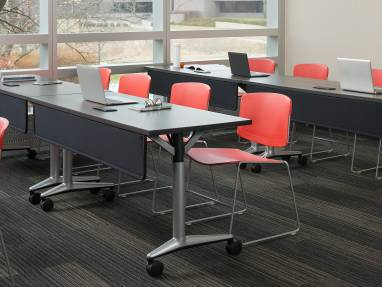 Red Max Stacker III chairs in a meeting room