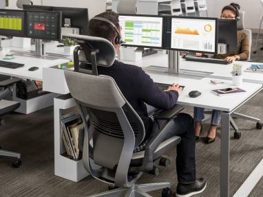 man leaning back in Gesture office chair with headrest