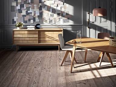 Bolia Mood dining chairs are placed by a wood table and a Bolia storage credenza