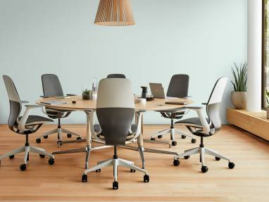 Six SILQ chairs around a circular table