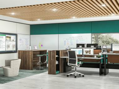 An office space with whiteboard walls features Steelcase Migration desks, Think chairs, a Turnstone Campfire Big Table, and Bassline table