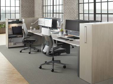 A workstation is created by using a FrameOne Resident Bench from Steelcase with high density storage and two Gesture desk chairs