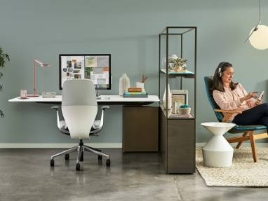 A Mackinac desk with SILQ chair is next to a lounge with Viccarbe Ace Chair with arms and FLOS lighting