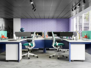 An office space decorated in shades of purple, teal and gray that features a workstation created with Answer beams, including privacy screens and desk storage.