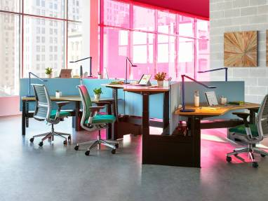 A group of workstations created with Ology benches and Gesture desk chairs