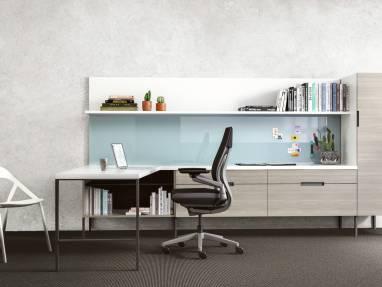 A Gesture desk chair and LessThanFive chair in an office with an Elective Elements workstation