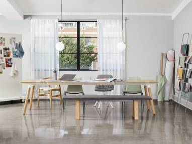 Wishbone chair, Montara650 chairs, Viccarbe Maarten seating, and a Viccarbe Trestle bench placed around a Potrero415 Light table