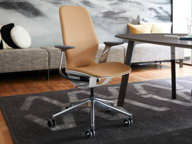 A SILQ office chair is shown next to a Verlay conference room table