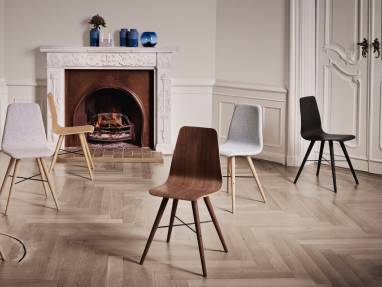 A collection of Bolia Beaver chairs are shown in various styles