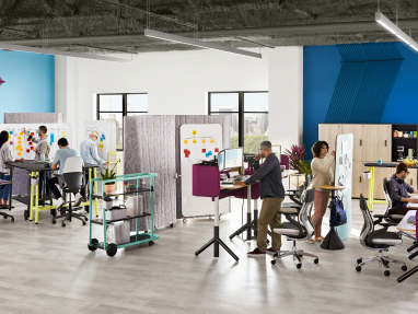A group of people works in an office environment created with Steelcase Flex Collection products