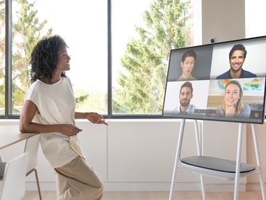 Woman participates in a video conference while using a Steelcase Roam