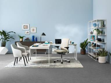 A West Elm Work Greenpoint private office with shelving, storage cabinet, West Elm Work Sterling chairs, and Steelcase Think desk chair