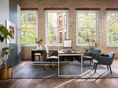 Private office with West Elm Greenpoint private office desk, two Bolia C3 chairs, and a SILQ desk chair