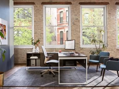 SILQ desk chair and Bolia C3 chairs next to a West Elm Work Greenpoint Private Office Desk