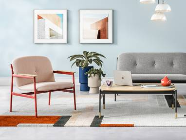 A lounge setting featuring West Elm Work products, including Brighton Chair, Brighton two seat and single seat seating, and a coffee table