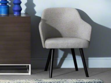 A West Elm Work Greenpoint Storage cabinet shown next to a West Elm Work Sterling chair