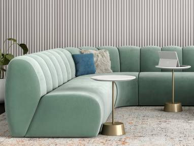 Office lounge with West Elm Work Belle Sectional with light green upholstery, Greenpoint Storage Credenza, and Maisie side tables