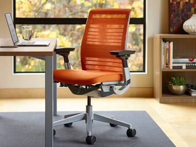 Think in Cogent: Connect Tangerine (5S17) with a platinum frame and base and Martin Desk in Virginia Walnut (25L5)