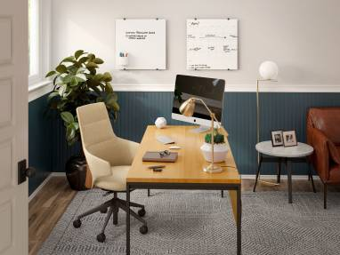 Home office space equipped with PolyVision Nota whiteboards, a beige Massaud Conference chair and a wooden desk.