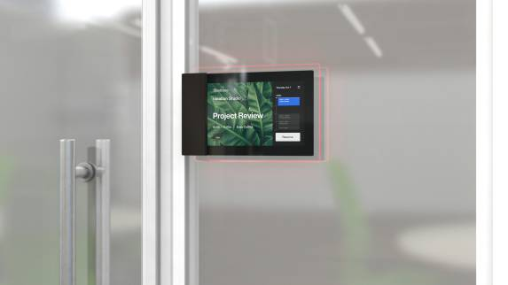 Roomwizard on a transparent door showing a booked meeting