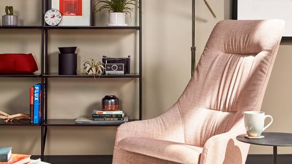 A Viccarbe Nagi armchair with pink upholstery in a lounge setting