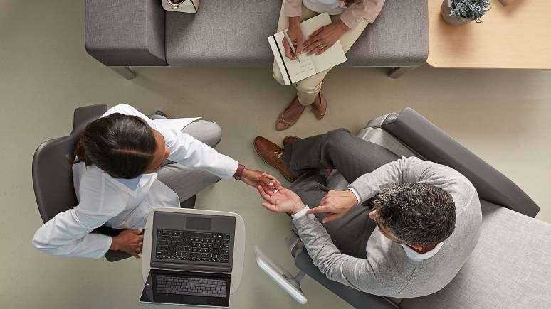 An overhead photo showing three people sitting in Steelcase seating in a healthcare setting