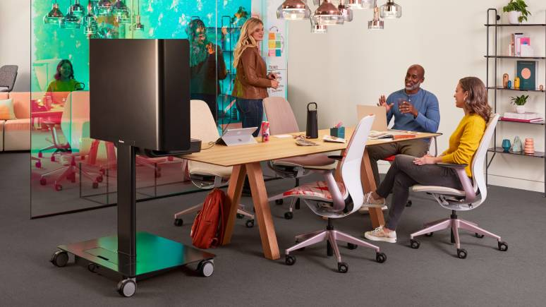 Three people work collaboratively in an open-office collaboration setting furnished with SILQ and Steelcase Flex Mobile Power.