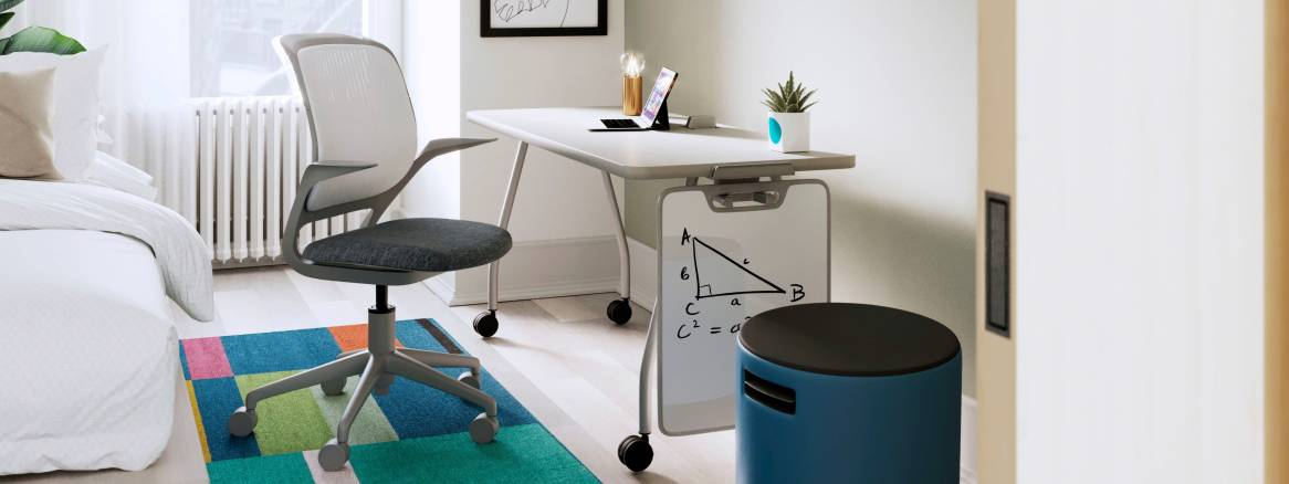 Bedroom space equipped with a bed, a white Verb Rectangular Table, a Verb Whiteboard, a gray Cobi Office Chair and a blue Buoy Stool.