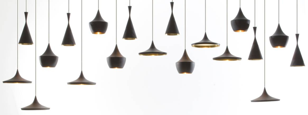several Tom Dixon Pendant hanging from the ceiling