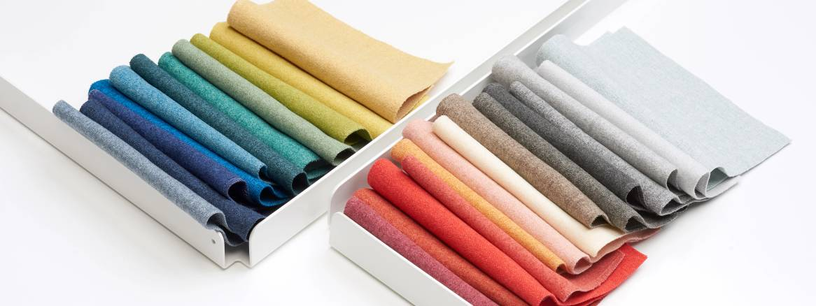 bunch of colorful fabrics on top of a table