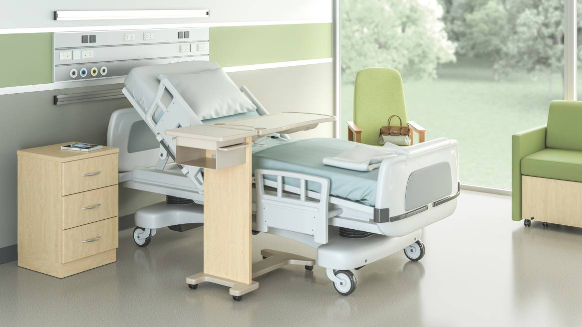 Opus Overbed Table by a patient bed in a hospital room