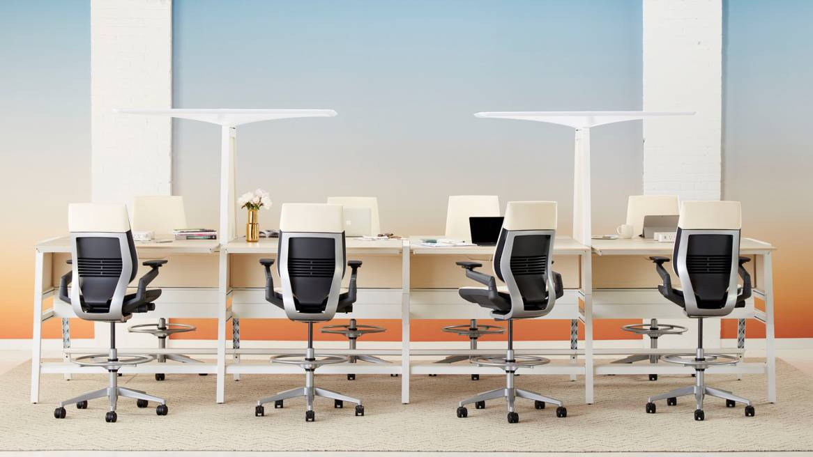 Bivi desks create a workstation for 8 people with Gesture chairs in stool height and Bivi canopies attached to the desks