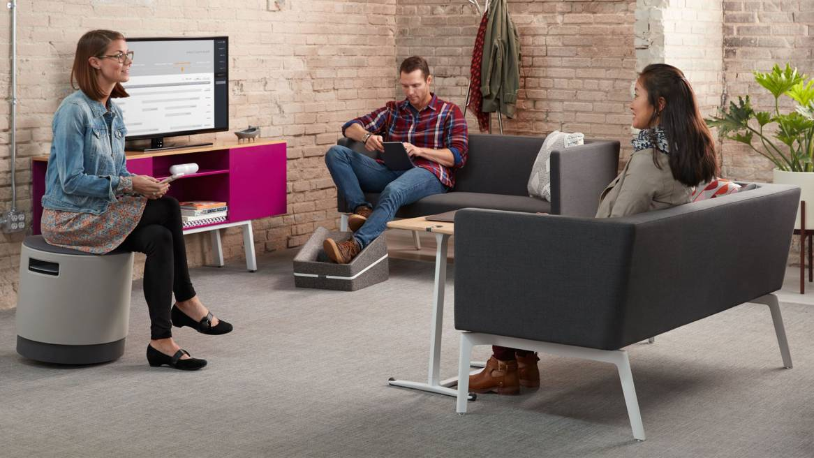 Three people sitting in a lounge area with two Grey Bivi Rumble Seats