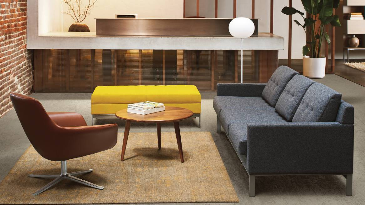 An office reception area with residential-inspired design features Bob lounge seating, a CH008 table, and a Millbrae Lifestyle Lounge sofa