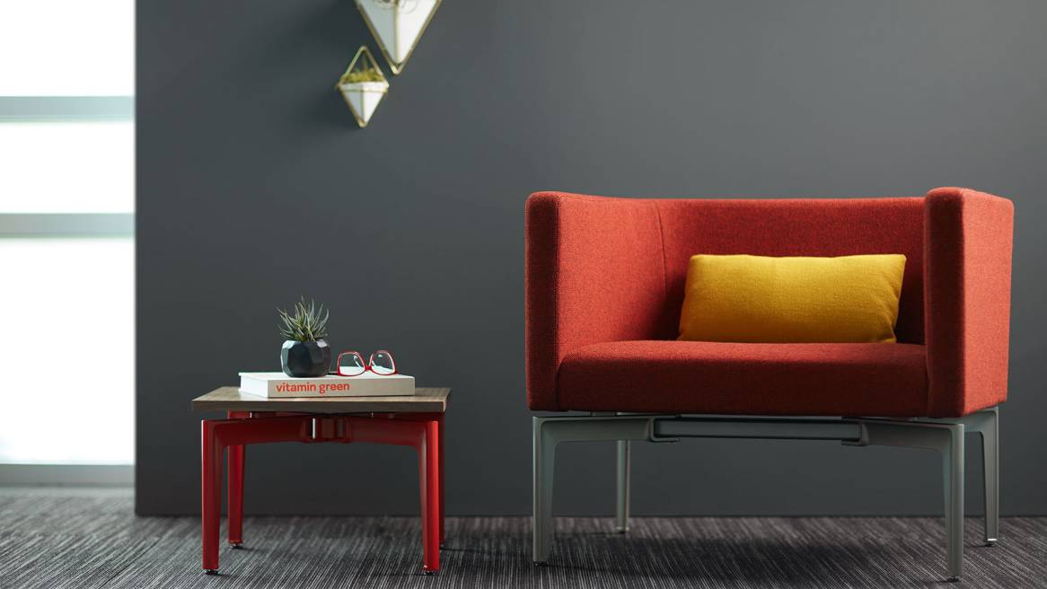 Red Bivi Rumble Seat next to a Red base Bassline side table