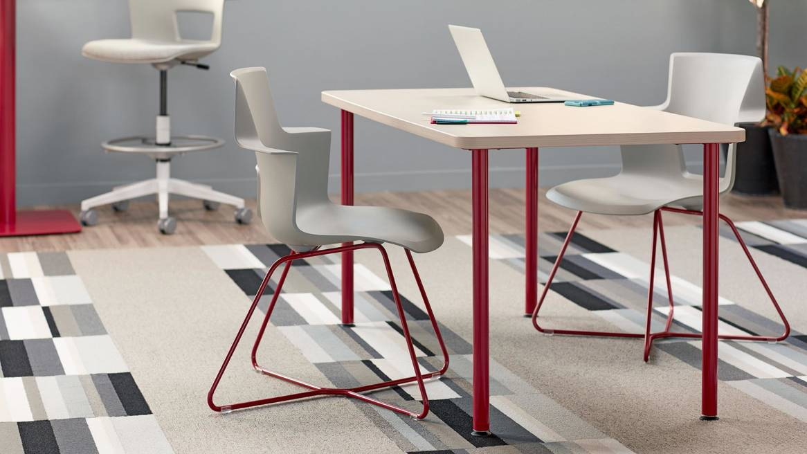 Shortcut X Base chair at a table