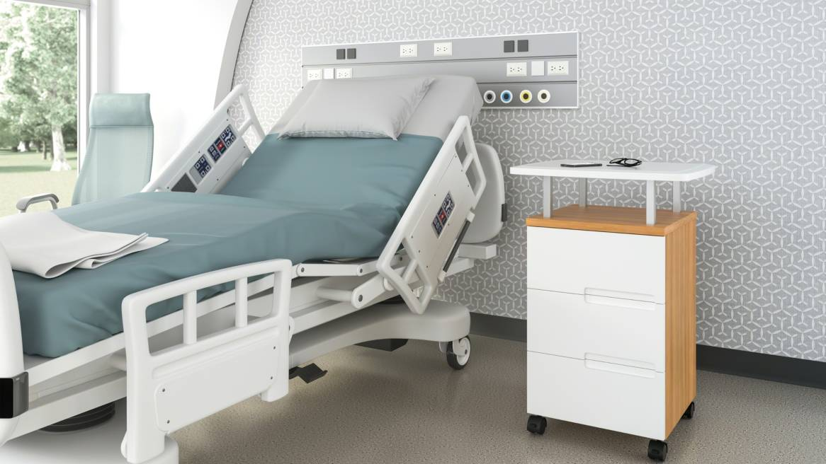 A Park Mobile cabinet with three drawers is shown next to a hospital bed