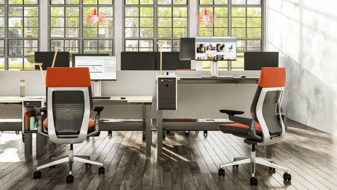 Ology height adjustable benching shown in seated and standing heights with Gesture task chairs at each desk