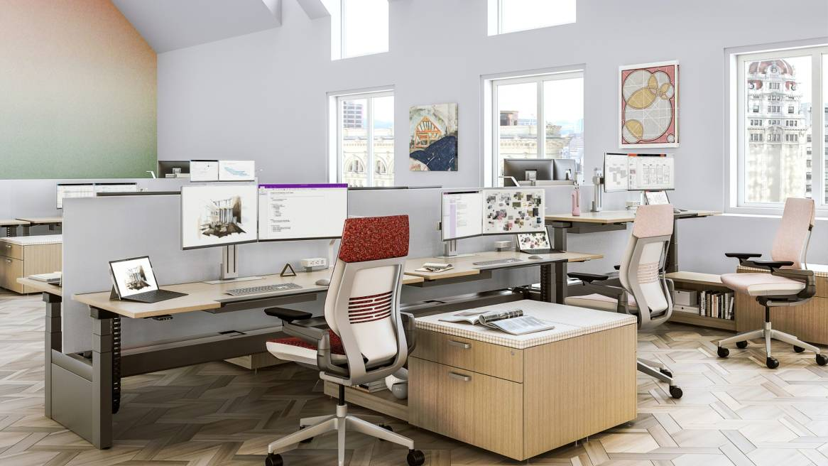 Three Ology height adjustable benches in a row with Gesture desk chairs and Universal storage
