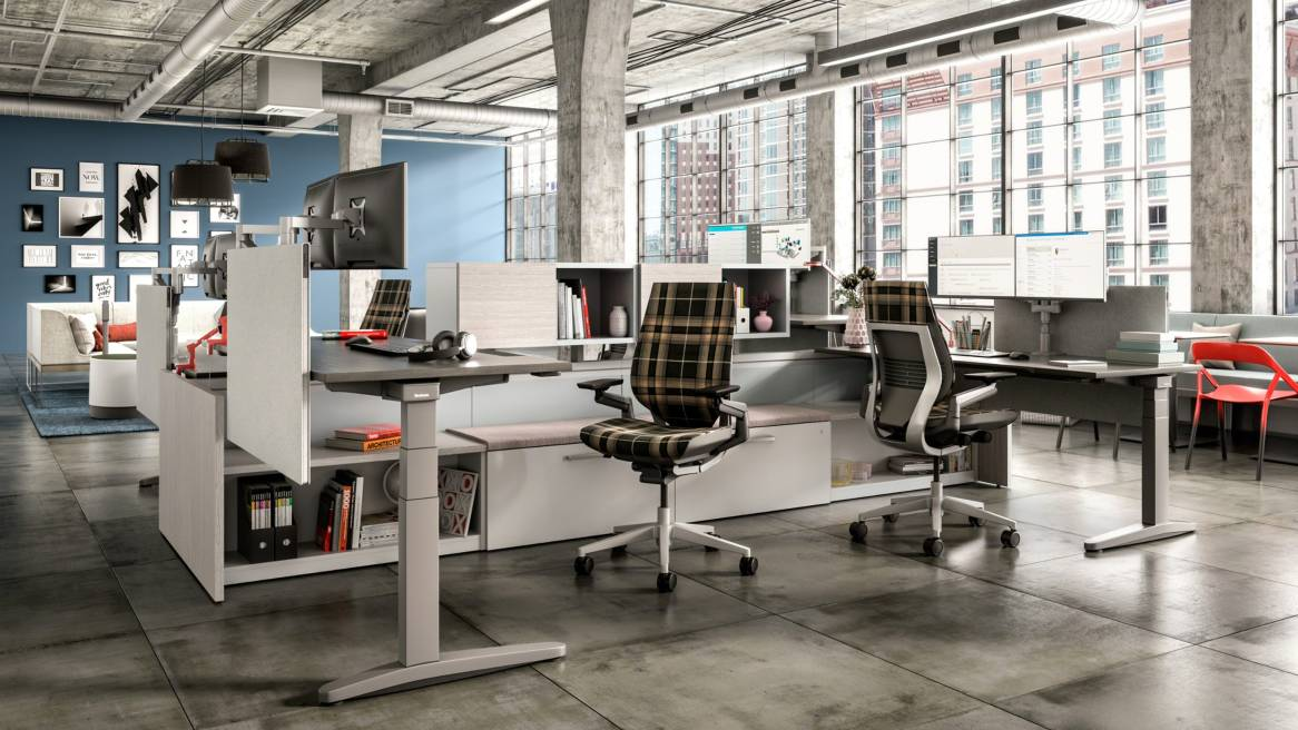 Office setting featuring Answer Beam, Ology height adjustable desks, Universal privacy screens, and Gesture task chairs