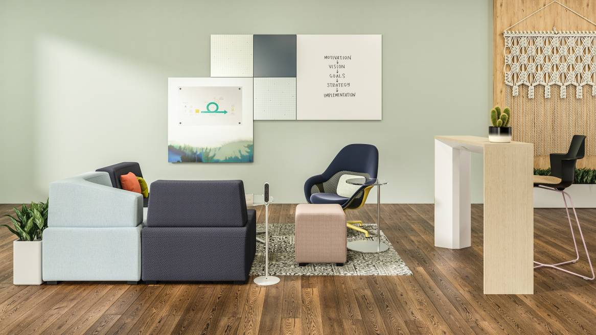 Ancillary space with lounge chairs and sofas, in front of a Motif Collaborative Panel System