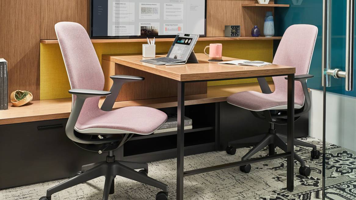 SILQ chairs with pink upholstery next to a desk in a private enclave