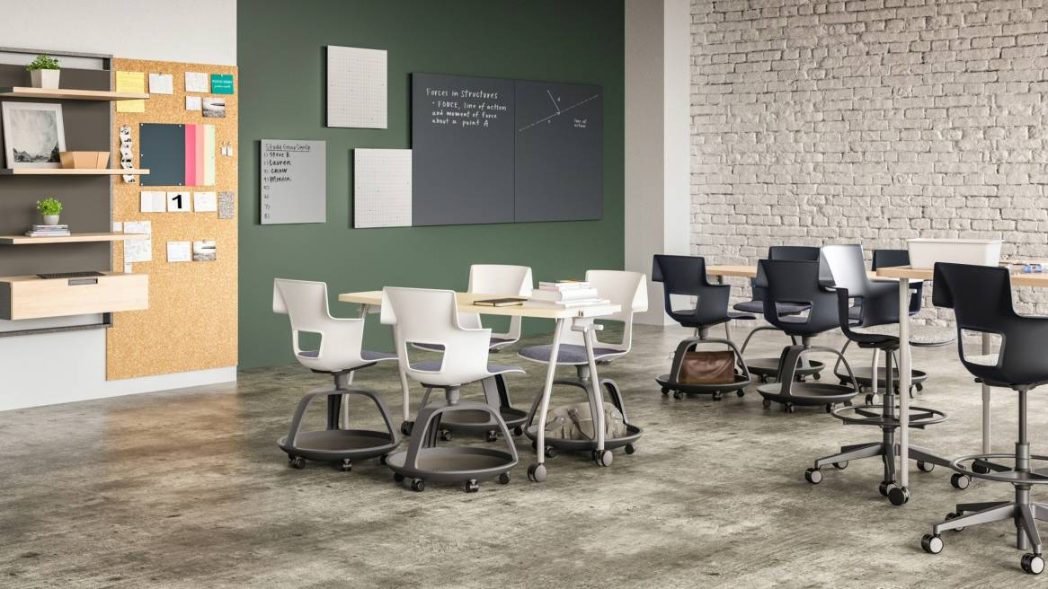 White and dark gray Shortcut tripod base and 5-star base chairs and Verb tables in a classroom setting with Motif collaborative panels on the wall