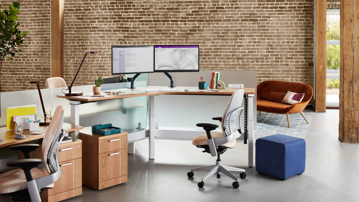 Workstation with Ology height adjustable bench, Leap desk chair, and Elective Elements pedestal with B-Free small cube and Philippa 2-seater sofa seen nearby