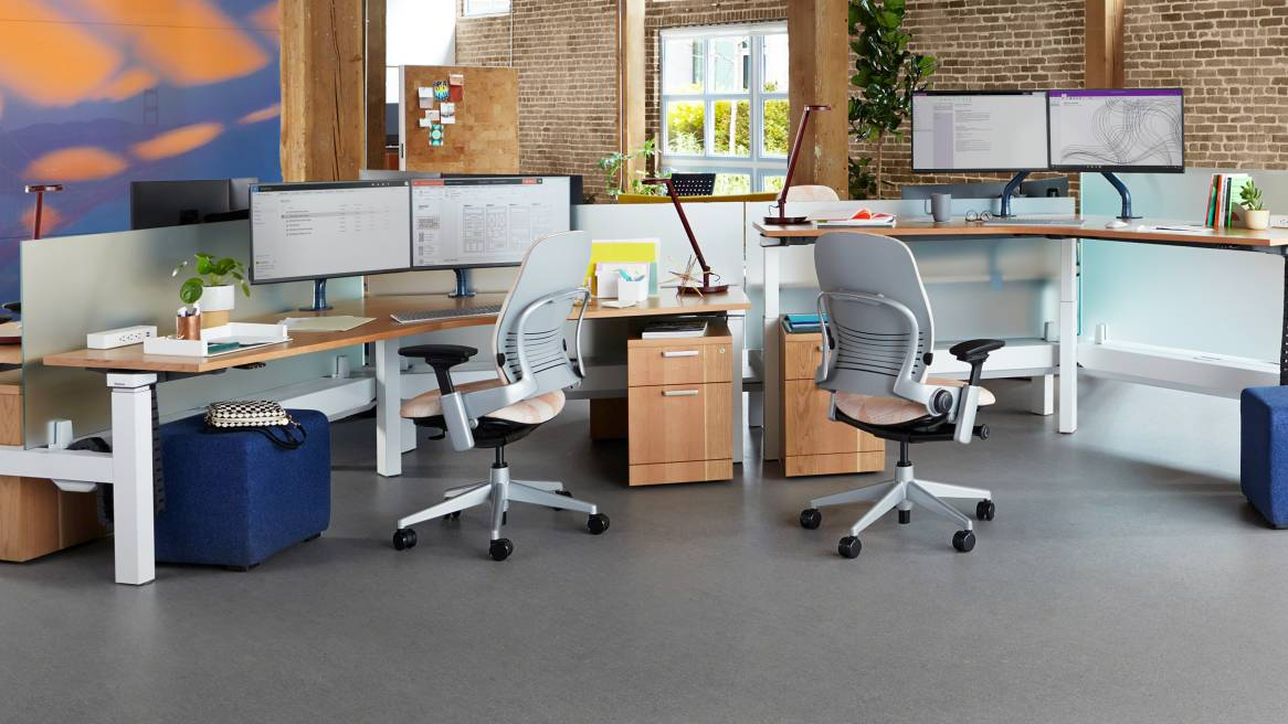 Two workstations with Ology height adjustable desks, Leap desk chairs, BFree small cubes, and Elective Elements pedestals