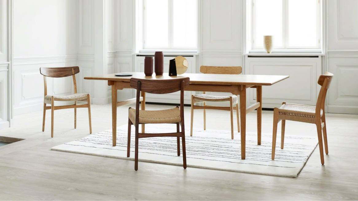 Carl Hansen & Son CH23 chairs placed around a rectangular table
