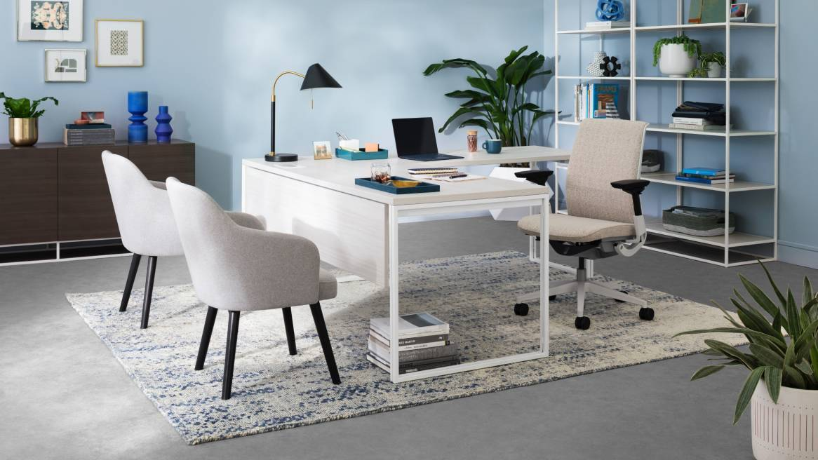 A private office with a West Elm Work Greenpoint desk, storage, West Elm Work Sterling chairs, and a Steelcase Think desk chair