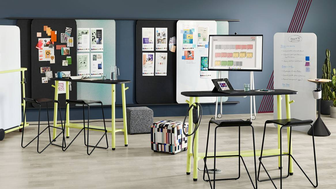 Workplace meeting area featuring Steelcase Flex Slim Tables, Blu Dot Ready barstools, Viccarbe Season Poufs, Flex Markerboards, Flex Screens, Flex Stand, Flex Board Cart, and Flex Power Hanger