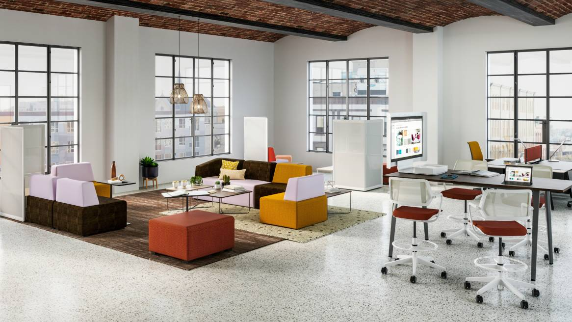 B-Free social zone featuring lounge seating, screens, and tables Qivi and Gesture chairs from Steelcase also pictured